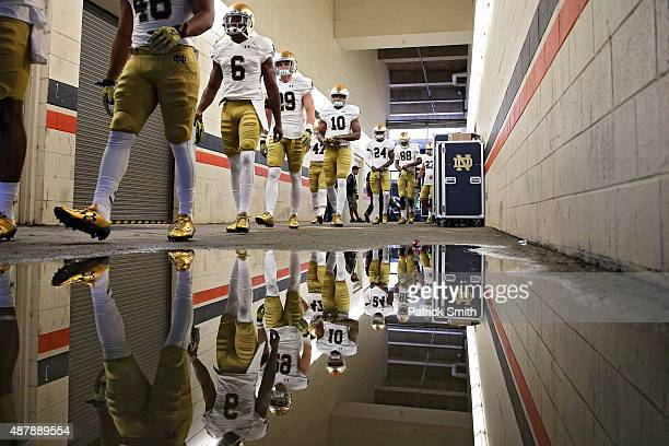 KeiVarae Russell of the Notre Dame Fighting Irish and teammates walk to the field for warmups before playing the Virginia Cavaliers at Scott Stadium...