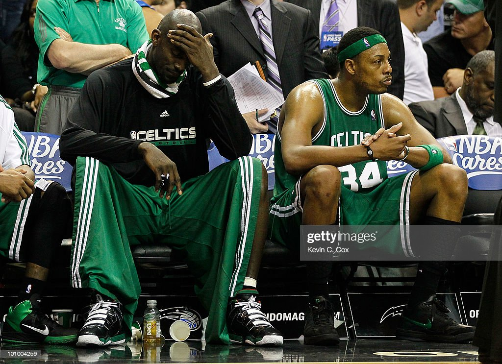 Keivn Garnett #5 and Paul Pierce #34 of the Boston Celtics look on dejected from the bench in the final minutes of their 113-92 loss to the Orlando Magic in Game Five of the Eastern Conference Finals during the 2010 NBA Playoffs at Amway Arena on May 26, 2010 in Orlando, Florida.