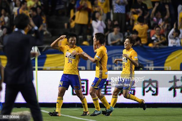 Keiya Shiihashi of Vegalta Sendai celebrates scoring his side's third goal with his team mates during the JLeague J1 match between Cerezo Osaka and...