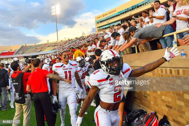 Keke Coutee of the Texas Tech Red Raiders interacts with fans before the game between the Texas Tech Red Raiders and the Arizona State Sun Devils on...
