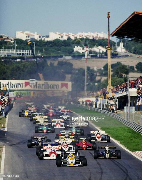 Keke Rosberg drives the Saudia Williams Honda Williams FW09B Honda 15 V6Turbo ahead of the field at the start of the Portuguese Grand Prix on 21st...