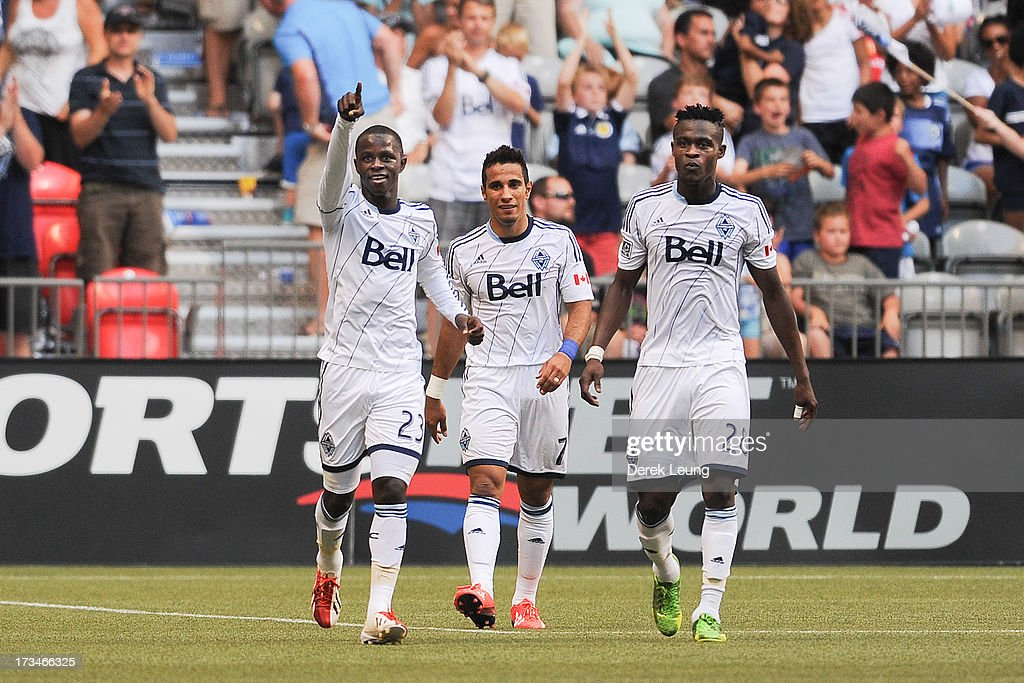 Kekuta Manneh #23 of the Vancouver Whitecaps celebrates after scoring the Whitecaps' third goal against Chicago Fire with his teammates Camilo Sanvezzo #7 (center) and Gershon Koffie #28 (right) during an MLS Match at B.C. Place on July 14, 2013 in Vancouver, British Columbia, Canada. The Vancouver Whitecaps won 3-1.
