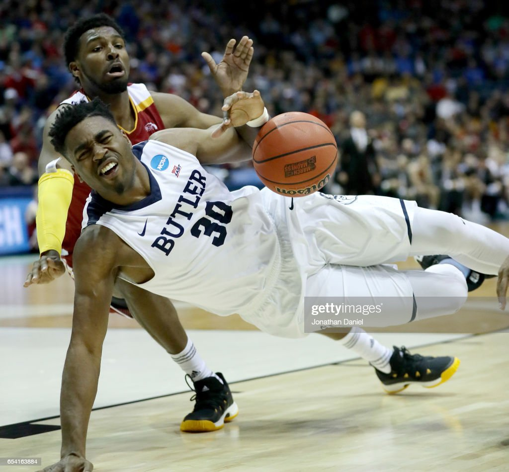 Kelan Martin #30 of the Butler Bulldogs falls to the ground after being fouled by Joshua Davenport #42 of the Winthrop Eagles in the second half during the first round of the 2017 NCAA Men's Basketball Tournament at BMO Harris Bradley Center on March 16, 2017 in Milwaukee, Wisconsin.