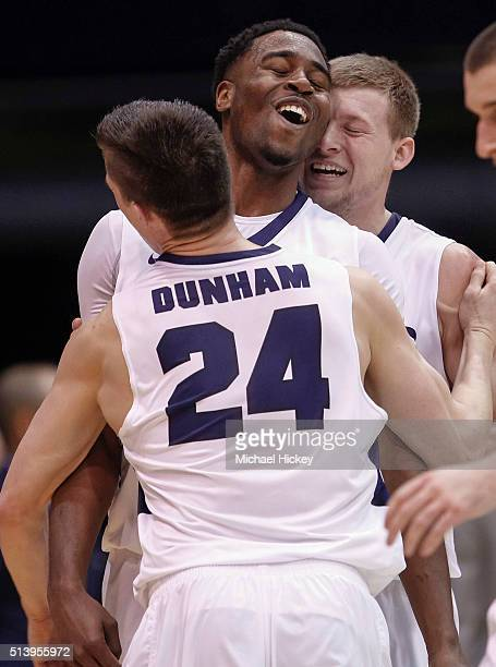 Kelan Martin of the Butler Bulldogs is embraced by teammates during a timeout during the game against the Marquette Golden Eagles at Hinkle...