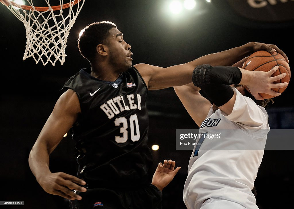 Kelan Martin of the Butler Bulldogs stuffs the shot of Will Artino of the Creighton Bluejays during their game at CenturyLink Center February 16 2015...