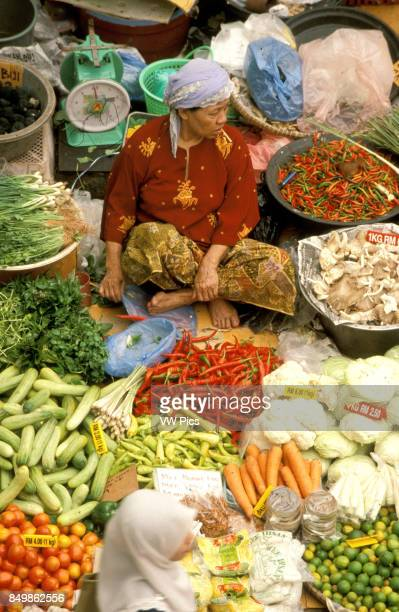 Kelantan State Kota Bharu Women selling fruit and vegetables in the towns central market Malaysia