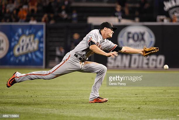 Kelby Tomlinson of the San Francisco Giants can't make the catch on a single hit by Derek Norris of the San Diego Padres during the second inning of...