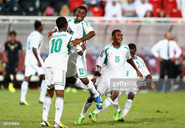 Kelechi Iheanacho Chigozi Obasi Raymond Japhet and Abdullahi Alfa of Nigeria celebrate their victory after the FIFA World Cup UAE 2013 Final between...