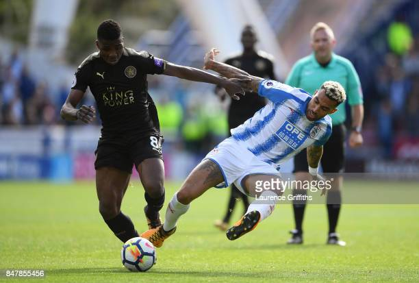 Kelechi Iheanacho of Leicester City and Danny Williams of Huddersfield Town battle for possession during the Premier League match between...