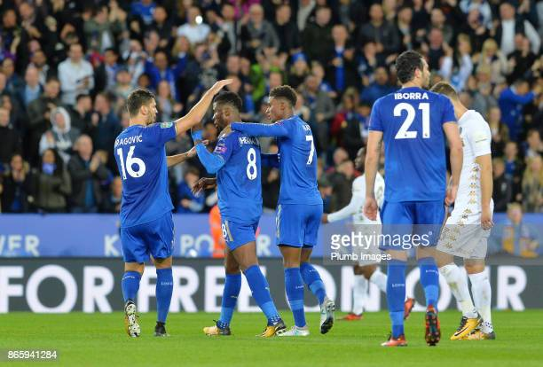 Kelechi Iheanacho of Leicester City celebrates with Akleksandar Dragovic and Demarai Gray of Leicester City after scoring from outside the box to...