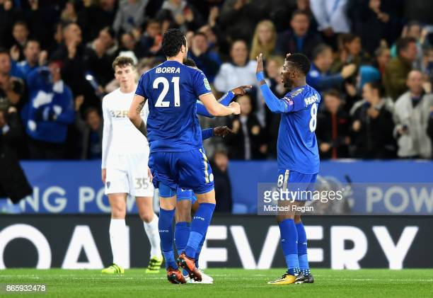 Kelechi Iheanacho of Leicester City celebrates with teammates after scores his sides first goal during the Caraboa Cup Fourth Round match between...