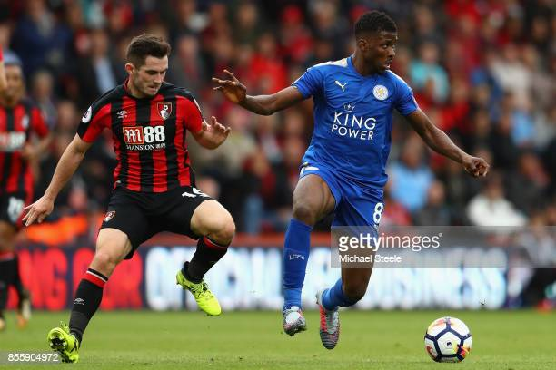 Kelechi Iheanacho of Leicester City controls the ball under pressure of Lewis Cook of AFC Bournemouth during the Premier League match between AFC...