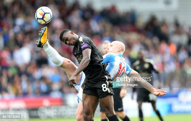 Kelechi Iheanacho of Leicester City in action with Aaron Mooy of Huddersfield Town during the Premier League match between Huddersfield Town and...