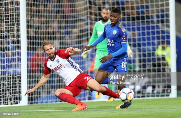 Kelechi Iheanacho of Leicester City in action with Craig Dawson of West Bromwich Albion during the Premier League match between Leicester City and...