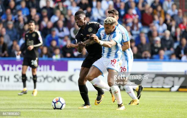Kelechi iheanacho of Leicester City in action with Danny Williams of Huddersfield Town during the Premier League match between Huddersfield Town and...