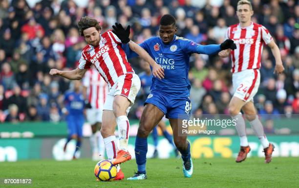 Kelechi Iheanacho of Leicester City in action with Joe Allen of Stoke City during the Premier League match between Stoke City and Leicester City at...