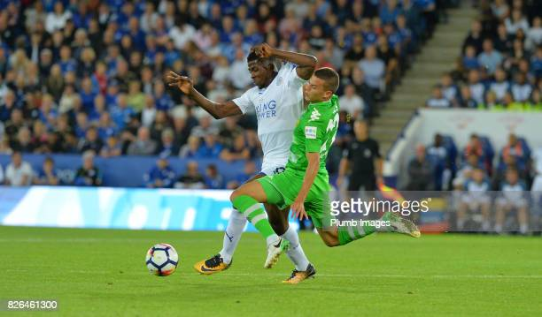 Kelechi Iheanacho of Leicester City is injured during a tackle by Laszio Benes of Borussia Monchengladbach during the Leicester City v Borussia...