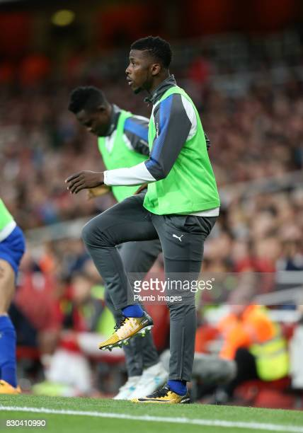 Kelechi Iheanacho of Leicester City warms up from the bench during the Premier League match between Arsenal and Leicester City at Emirates Stadium on...