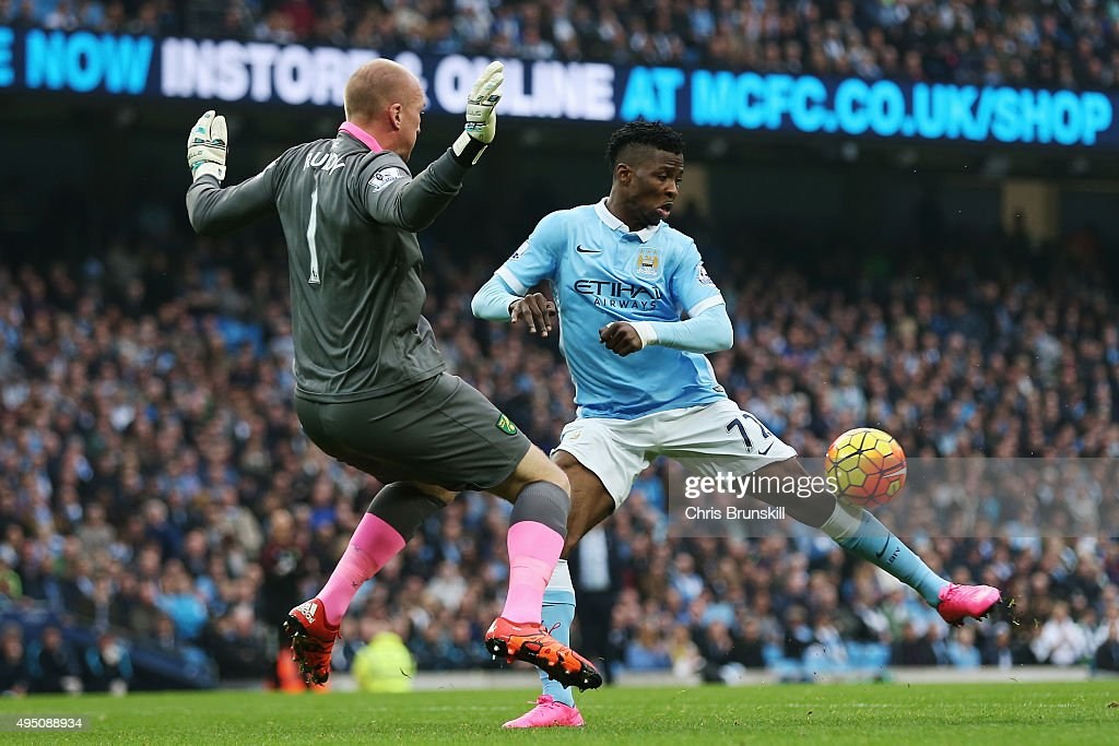 Kelechi Iheanacho of Manchester City and John Ruddy of Norwich City compete for the ball during the Barclays Premier League match between Manchester City and Norwich City at Etihad Stadium on October 31, 2015 in Manchester, England.