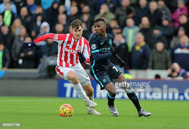 Kelechi Iheanacho of Manchester City and Philipp Wollscheid of Stoke City during the Barclays Premier League match between Stoke City and Manchester...
