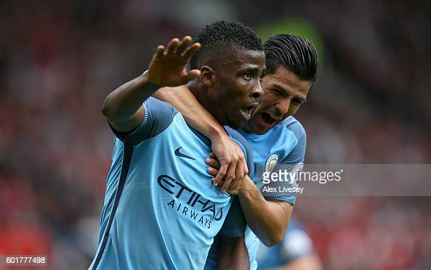 Kelechi Iheanacho of Manchester City celebrates scoring his sides second goal with his team mate Nolito of9 Marnch0este r City during the Premier...