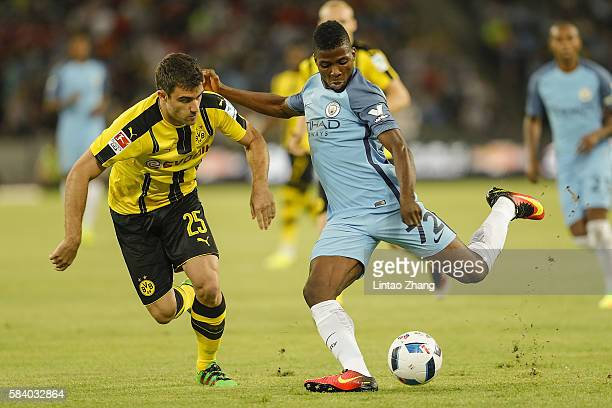 Kelechi Iheanacho of Manchester City contests the ball against Sokratis Papastathopoulos of Borussia Dortmund during the 2016 International Champions...
