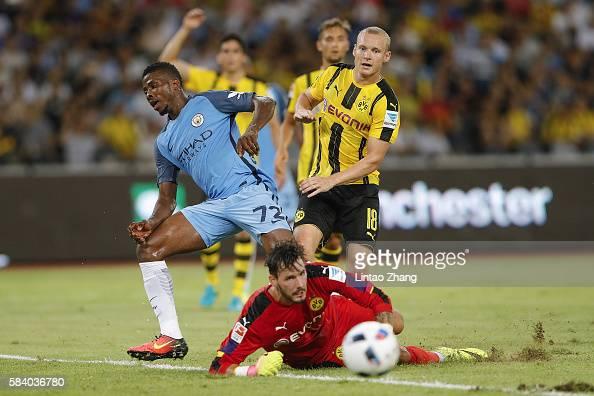 Kelechi Iheanacho of Manchester City contests the ball against Sebastian Rode and Roman Buerki of Borussia Dortmund during the 2016 International...