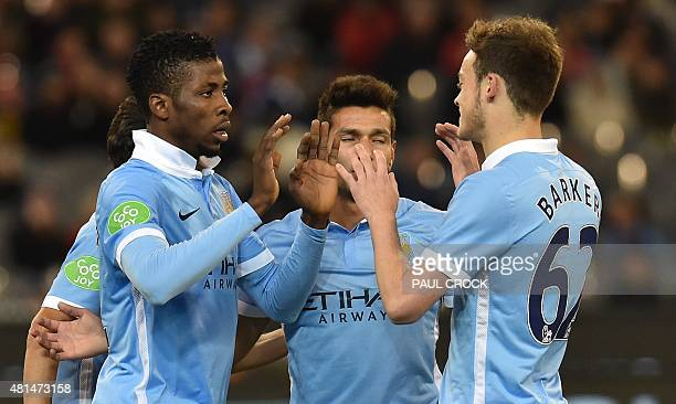 Kelechi Iheanacho of Manchester City is congratulated by teammates after scoring a goal at the International Champions Cup football match between...