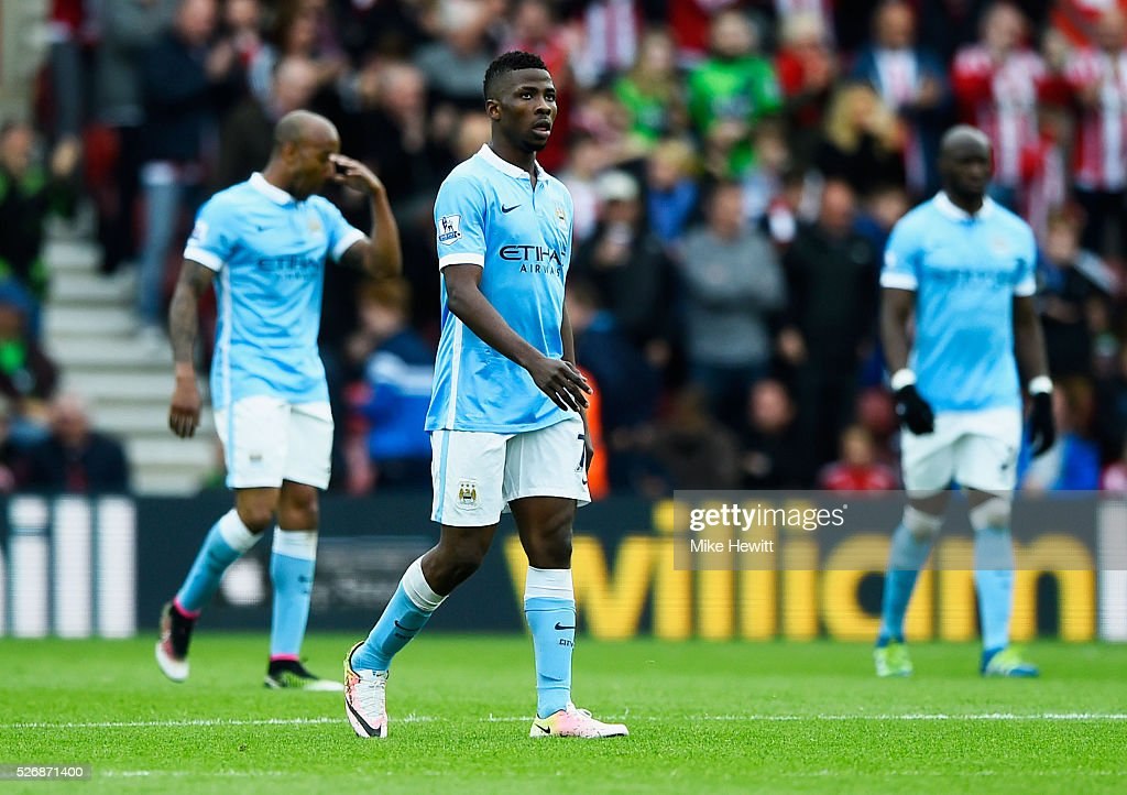 <a gi-track='captionPersonalityLinkClicked' href=/galleries/search?phrase=Kelechi+Iheanacho&family=editorial&specificpeople=11503326 ng-click='$event.stopPropagation()'>Kelechi Iheanacho</a> of Manchester City (C) looks despondent as Sadio Mane of Southampton scores their third goal during the Barclays Premier League match between Southampton and Manchester City at St Mary's Stadium on May 1, 2016 in Southampton, England.