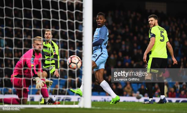 Kelechi Iheanacho of Manchester City scores their fifth goal past goalkeeper Joel Coleman of Huddersfield Town during The Emirates FA Cup Fifth Round...