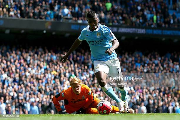 Kelechi Iheanacho of Manchester City takes the ball past Jakob Haugaard of Stoke City to score his second and his sides fourth goal during the...