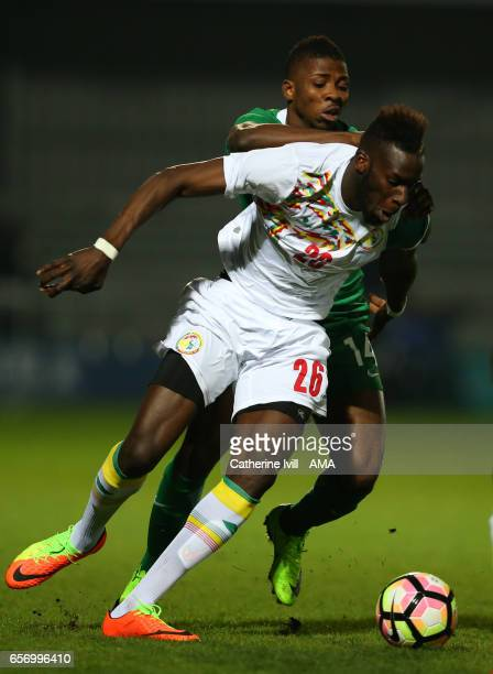 Kelechi Iheanacho of Nigeria and Salif Sane of Senegal during the International Friendly match between Nigeria and Senegal at The Hive on March 23...