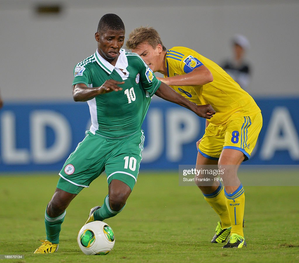 Kelechi Iheanacho of Nigeria challenges for the ball with Elias Andersson of Sweden during the FIFA U17 group F match between Sweden and Nigeria at Khalifa Bin Zayed Stadium on October 22, 2013 in Al Ain, United Arab Emirates.