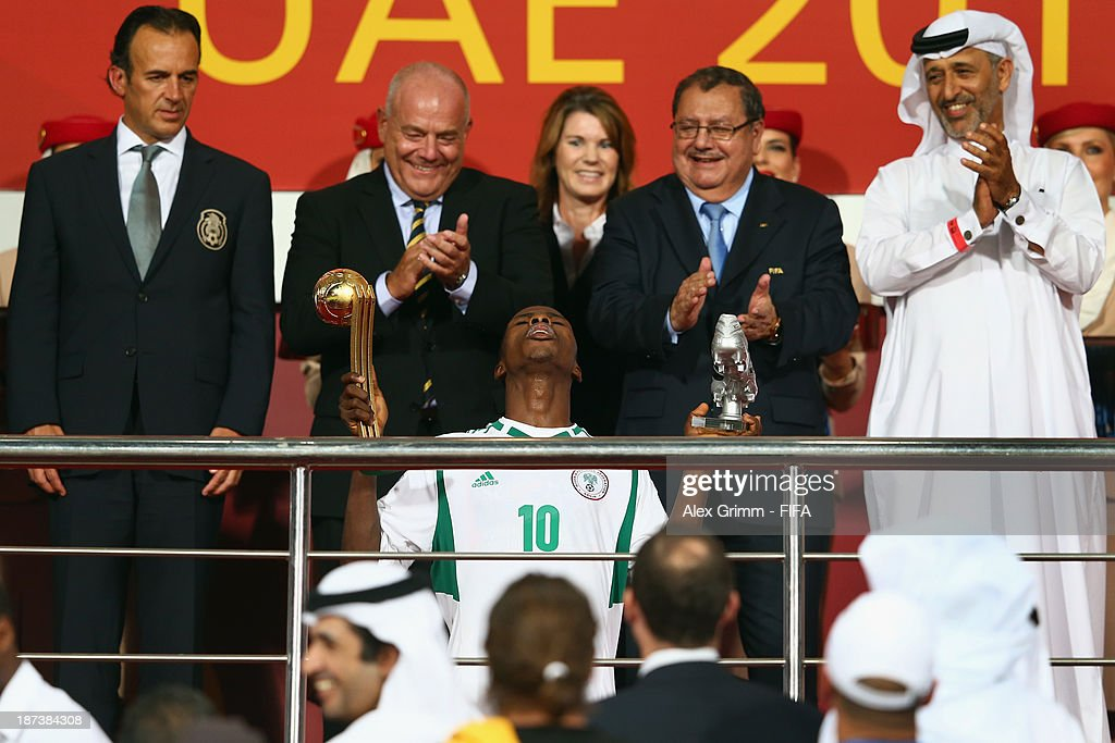 Kelechi Iheanacho of Nigeria kneels down with the Golden Ball and the Silver Shoe after his team won the FIFA U-17 World Cup UAE 2013 Final between Nigeria and Mexico at Mohamed Bin Zayed Stadium on November 8, 2013 in Abu Dhabi, United Arab Emirates.