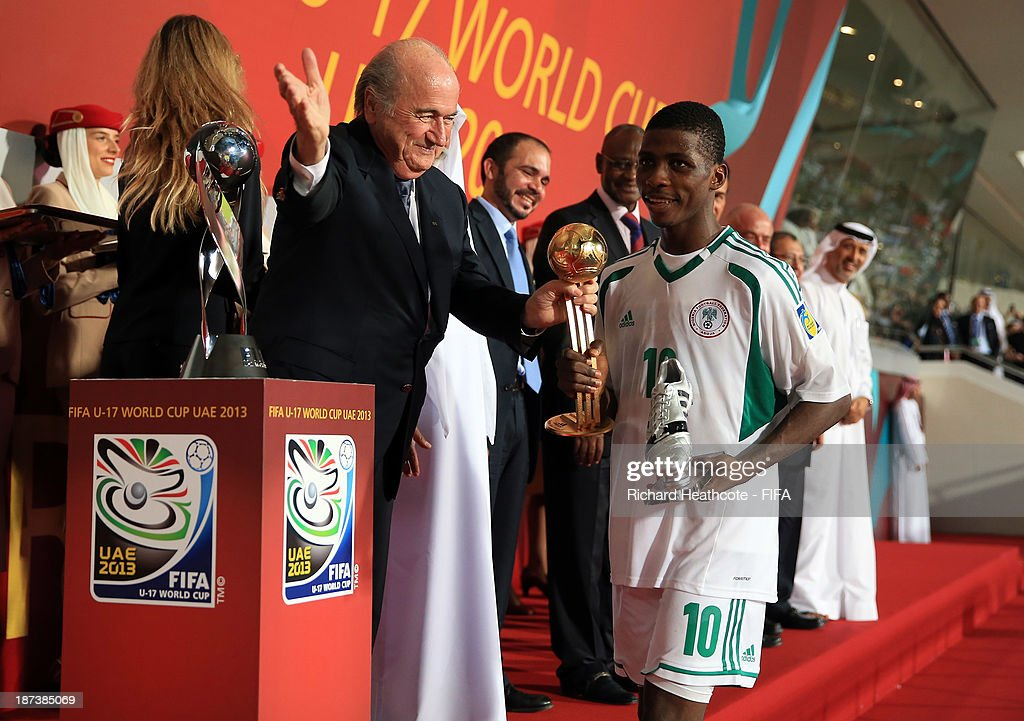Kelechi Iheanacho of Nigeria recieves the Golden Ball and the Silver Boot from FIFA President Joseph S. Blatter during the FIFA U-17 World Cup UAE 2013 Final between Nigeria and Mexico at the Mohamed Bin Zayed Stadium on November 8, 2013 in Abu Dhabi, United Arab Emirates.