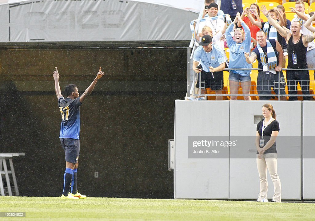 Kelechi Ihenacho #67 of Manchester City celebrates after scoring in the first half against AC Milan during International Champions Cup 2014 at Heinz Field on July 27, 2014 in Pittsburgh, Pennsylvania.