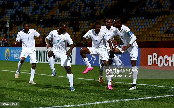 Kelechi Nwakali of Nigeria celebrate with his team mates after he scores the 2nd goal by penalty kick during the FIFA U17 Men's World Cup 2015 round...