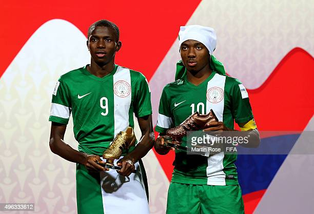 Kelechi Nwakali of Nigeria poses with the adidas bronze boot and team mate Victor Osimhen of Nigeria poses with the adidas golden boot after the FIFA...
