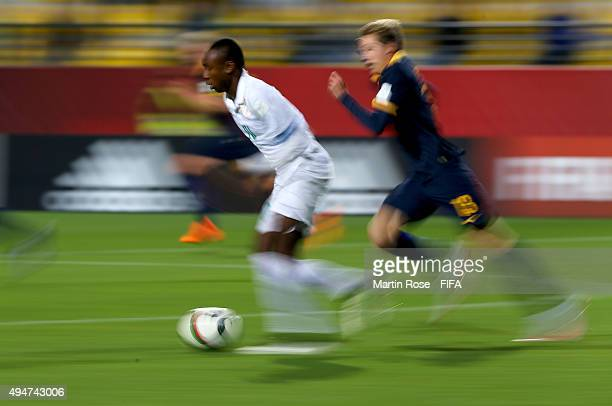 Kelechi Nwakali of Nigeria runs with the ball during the FIFA U17 Men's World Cup 2015 round of 16 match between Nigeria and Australia at Estadio...