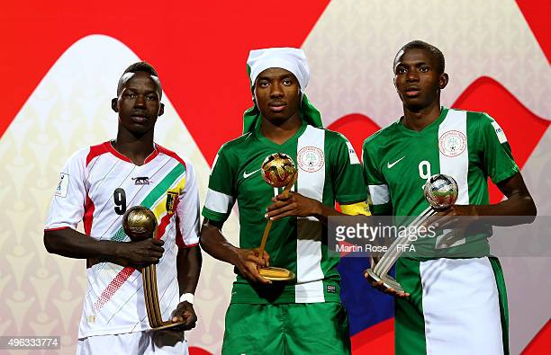 Kelechi Nwakali of Nigeria winner of the adidas Golden Ball poses with Victor Osimhen of Nigeria and Aly Malle of Mali after the FIFA U17 Men's World...