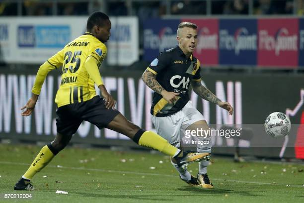 Kelechi Nwakali of VVV Venlo Jose Angelino of NAC Breda during the Dutch Eredivisie match between VVV Venlo and NAC Breda at Seacon stadium De Koel...