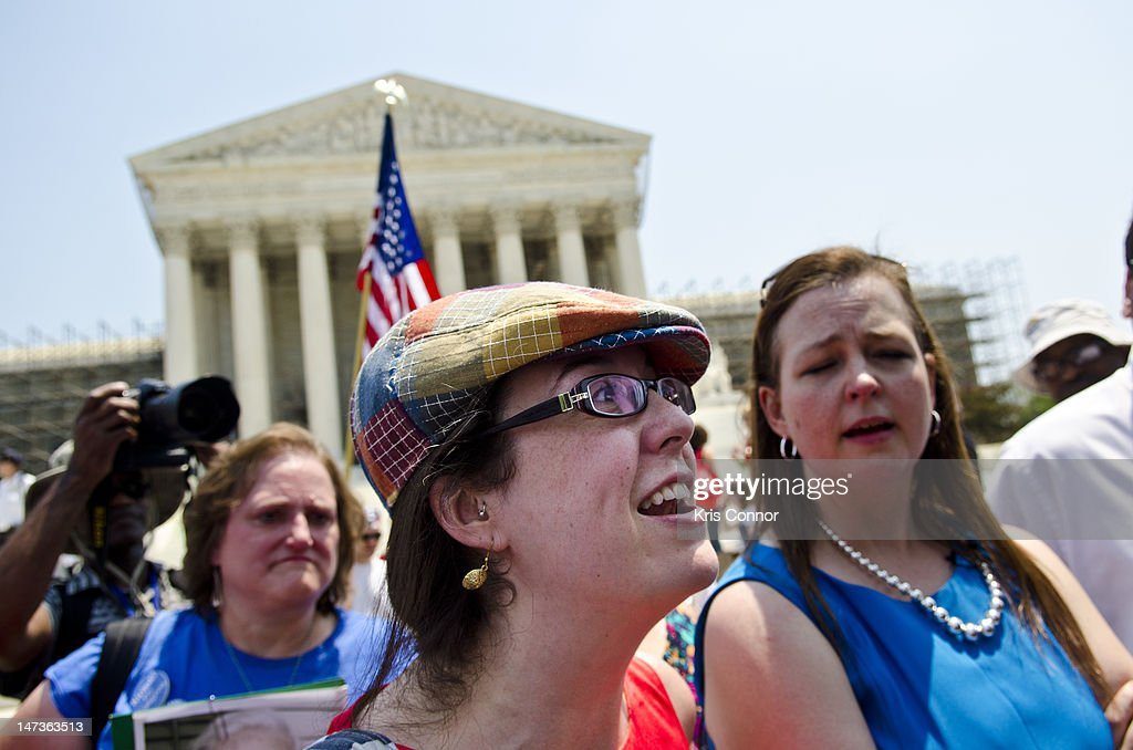 Keli Carender and Jenny Beth Martin argue with a another protester about the Affordable Healthcare Act outside the U.S. Supreme Court on June 28, 2012 in Washington, DC. The Court found the law to be constitutional and did not strike down any part of it.