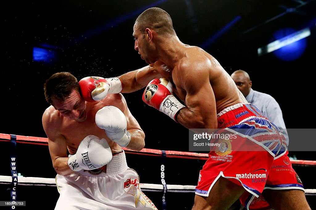 Kell Brook (R) finishes Vyacheslav Senchenko with a right hook to the templ during their Final Eliminator for the IBF World Welterweight Championship bout at Motorpoint Arena on October 26, 2013 in Sheffield, England.