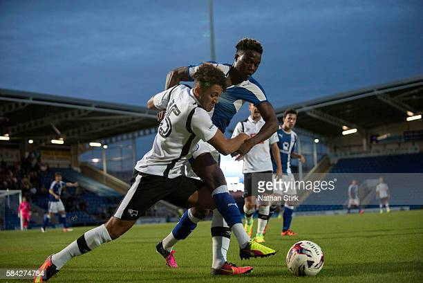 Kellan Gordon of Derby County and Gboly Ariyibi of Chesterfield battle for the ball during the PreSeason Friendly between Chesterfield and Derby...