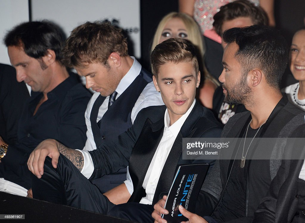 Kellan Lutz (2L) and Justin Bieber (2R) attend the Amber Lounge 2014 Gala at Le Meridien Beach Plaza Hotel on May 23, 2014 in Monaco, Monaco.