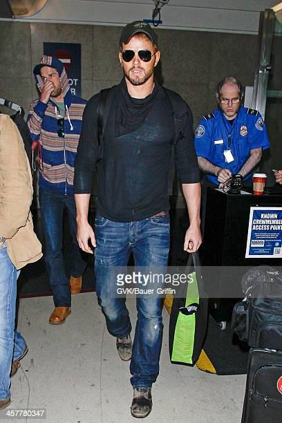 Kellan Lutz is seen at Los Angeles International airport on December 18 2013 in Los Angeles California