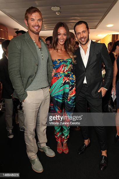 Kellan Lutz Sharni Vinson and designer Massimiliano Giornetti pose backstage during the Salvatore Ferragamo show as part of Milan Fashion Week...