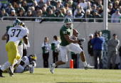Kellen Davis of the Michigan State Spartans carries the ball during the game against the Michigan Wolverines at Spartan Stadium November 3 2007 in...