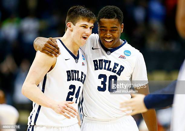 Kellen Dunham and Kelan Martin of the Butler Bulldogs celebrate their 56 to 48 win over the Texas Longhorns during the second round of the 2015 NCAA...