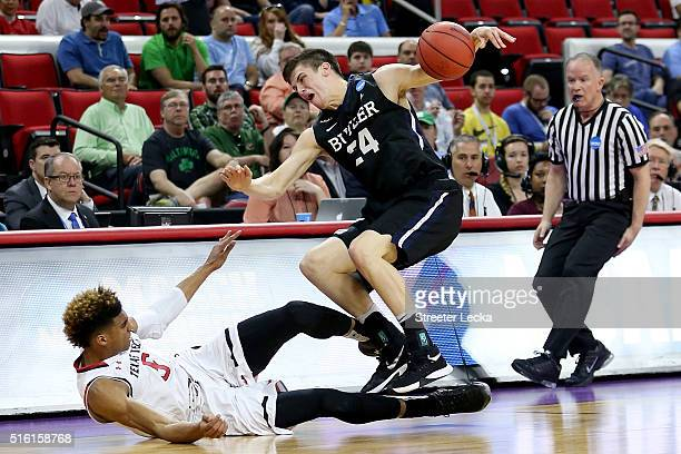 Kellen Dunham of the Butler Bulldogs and Justin Gray of the Texas Tech Red Raiders go after a loose ball in the first half in the first round of the...